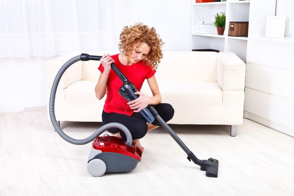 woman fixing vacuum